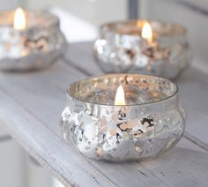 Antique silver candle holders or Thrift store glass covered with lace doilly then spray painted silver....hmmmm