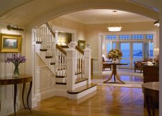 A nice curved ceiling adds a nice accent to a beautiful open tread staircase.