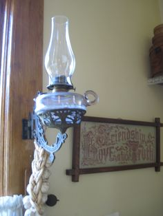 Put an oil lamp on the wall in the kitchen.