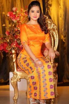A Burmese Girl Wearing A Stunning Red Acheik Longyi