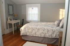 French Gray paint apt bedroom wall. Love the bedspread