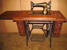 Singer Red Eye 66 Tiger Oak Treadle Sewing Machine:  Like the cabinet, machine may need work.