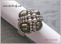 10% OFF for purchase of $25 and above. Simply use the coupon code <10off25> during checkout to enjoy. This ring tutorial includes details, easy step by step instructions with colour photos/pictures and all of materials list. It is made using swarovski pearl, metal beads and seed beads. You can also found this ring in the Pearl Ring Bundle Series I. Time required approximately 1 hr Number of pages 11 Number of Steps 24 Skill Level: Beginner/Intermediate This tutorial is f...