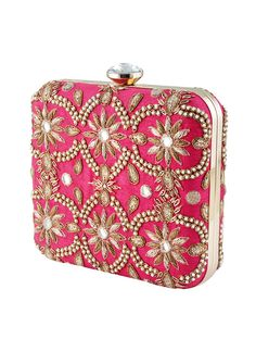 This gorgeous handcrafted pink box clutch by The Purple Sack showcases a pretty beaded symmetric pattern which is sure to beautifully complement your festive and wedding looks. It features a diamante clasp closure and detachable chain strap link. The elaborate charming design at the front is beautifully replicated at the back as well.