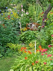 486250 - Globe thistles (Echinops), day lilies (Hemerocallis), hollyhocks (Alcea) and bee balms (Monarda)