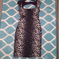 Leopard Print Pencil Dress! Freshly dry cleaned. A Jessica Simpson black and gray leopard pencil dress. Fits snug to the body. I'm just shy of 6ft and the dress hits me almost to the knees. Has a slit up the bottom on back and a cutout on the top part of the back.  trades. Fully lined and thick well made material. Jessica Simpson Dresses