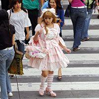 Japan - Japanese Girl Dressed in Lolita Fashion Crossing a Street in Tokyo