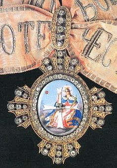 The Order of St. Catherine, the only Order of the Russian Empire for women (excluding the Order of Saint Olga, given only in 1916-1917), was founded in 1714 in order to commemorate and immortalize the actions of Empress Catherine I, wife of Peter the Great, whose selfless sale of her jewelry and property to pay the ransom of the Cossacks who were captured by the Turks in 1711 earned her the admiration of the court and country.