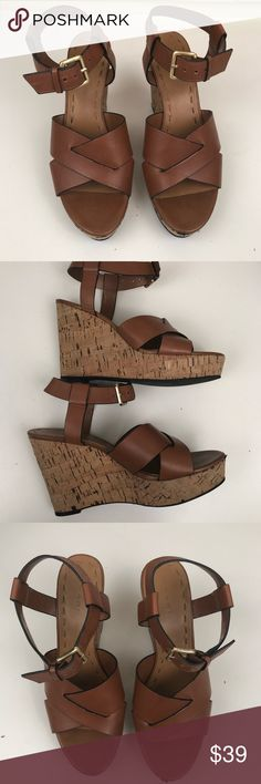 """Tahari Cognac Ankle Strap Sandal Cork Wedges Gorgeous and extremely comfortable Tahari wedge sandals. Features a criss cross design at top of foot and ankle straps with gold buckles. Cork style wedge. In very good used condition. Size is not listed on shoes, but they are a size 8. Wedge is approx 4"""" at its tallest point. Tahari Shoes Wedges"""