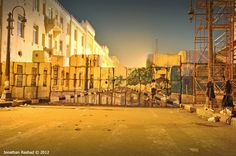 Graffiti by Ammar Abo Bakr and his crew. drawn on the wall blocking access to Ministry of Interior, photographed by Jonathan Rashad