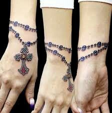 Rosary wrist tattoo