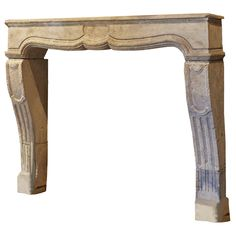 18th century French stone chimneypiece with fluting on the jambs.