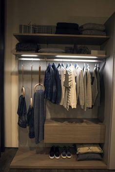 Sleek shelves and lighting combine to create a cool corner wardrobe http://ww...