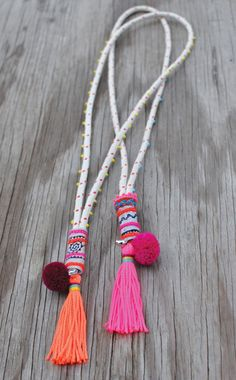Archery Collections , Rope Tassel Necklace www. The tassel with woven ribbon and a mini pompom sewn on would be a fun embellishment for all sorts of things. I would use yarn for the pompom, but tie it up with strong button and craf Archery Collections is Tassel Jewelry, Textile Jewelry, Fabric Jewelry, Ethnic Jewelry, Diy Jewelry, Jewelery, Jewelry Accessories, Handmade Jewelry, Jewelry Design