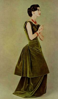 Model wearing a moss green velvet dress by Madame Gres and jewellery by Cartier, 1957.