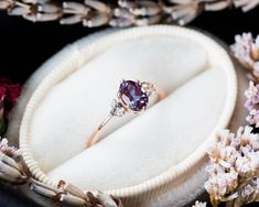 This beautiful, classic ring is made using solid gold and a gorgeous color changing Chatham made alexandrite. Ring details: -Main stone is a Chatham alexandrite, certification included. -Side stones are brilliant cut white sapphire. Alexandrite Engagement Ring, Rose Gold Engagement Ring, Vintage Engagement Rings, Diamond Wedding Bands, Alexandrite Ring, Oval Engagement, Ring Set, Ring Verlobung, Ring Rosegold
