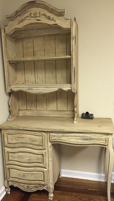 Originally black desk and hutch. Painted over with Annie Sloan old white, French linen wash and dark wax. Sanded down after old white to bring up some of the natural black for character