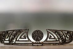 The 'Greek Key' design is a very popular with tiaras  worn by those not of royal origin too. This one followed a growing trend for using it as a motif and was made in 1905. It intersperses the geometric motif with laurel leaf branches, flanking a central stylised flower.