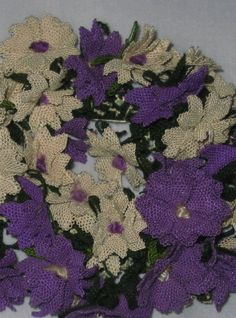 Oya--needle work craft building knots upon knot to form a flower. Here is the fragrant flower called Stock.