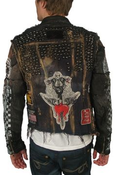 SO COOL! This hand made jacket from exclusive label, JUNKER has all the details that they are famous for. Made with a distressed denim torso with vintage leather arms. Check out the patchwork, stitching, vintage denim & leather pieces. Another great featu