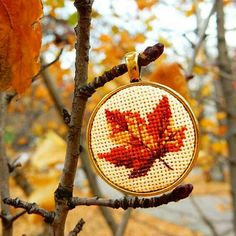 """Items similar to Crossstitch Autumn Leaf, handmade necklace, miniature crossstitch, handmade jewelry on Etsy The pendant """"Autumn Leaf"""" is handmade item with miniature (size of one microstitch is less than Size of pendant colour of the frame is gold. Diy Embroidery, Cross Stitch Embroidery, Cross Stitch Designs, Cross Stitch Patterns, Needlepoint Patterns, Diy Necklace Making, Homemade Necklaces, Handmade Items, Handmade Jewelry"""