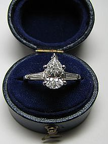 Pear shaped diamond with tapered baguettes. Now I wouldn't want a pear shaped engagement ring. But I still think it's pretty.
