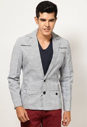 Look smart and stylish wearing this Grey coloured blazer from BLACKSOUL. Featuring checks all over, this full-sleeved blazer will fetch you loads of compliments wherever you go. Made from 100% cotton, this slim-fit blazer will keep you cool and comfortable all along.