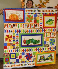 Interesting incorporation of additional quilt blocks Fabric Panel Quilts, Children's Quilts, Baby Quilts, Hungry Caterpillar Nursery, Very Hungry Caterpillar, Aaliyah Rose, Quilting Projects, Sewing Projects, Bubble Quilt