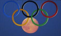 full moon through sochi Olympic rings | Olympic Rings and Tower Bridge | The World According to Sylvia Garza: Feb 13,2014