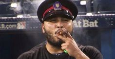 Dioner Navarro of the Toronto Blue Jays celebrates the 2015 ALDS series win against the Texas Rangers. Toronto Police Service. TPS. Major League Baseball. MLB. Cigars. Like a boss! World Series.