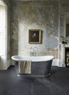 I'm so glad this old wall was kept the way it is. This bathroom is outstanding and would put a smile on your face every time you go for a bath.