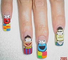 Aww...how cute....nails that have the cast of sesame street drawn on them:)