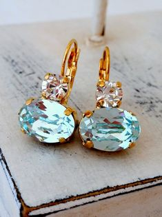 Ice blue and clear diamond crystal drop by EldorTinaJewelry Aquamarine Earrings, Blue Earrings, Bridal Earrings, Bridesmaid Earrings, Crystal Earrings, Crystal Jewelry, Dangle Earrings, Bridesmaid Gifts, Bridal Gifts