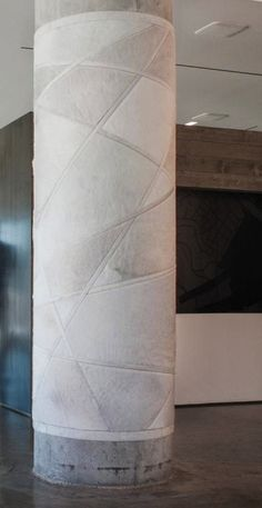 Kyle Bunting, widely recognized as creator of the decorative hide rug, is an innovator whose work over the past decade has redefined how hide is used in interior applications. Interior Columns, Interior Walls, Interior Architecture, Ceiling Design, Wall Design, Column Wrap, Jewelry Store Design, Column Design, Wall Treatments