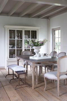 The finish I want on my dining room table, I love these chairs too. I also like the stability of the four legs. Style At Home, Home Theaters, Sweet Home, Dining Room Inspiration, Dining Room Table, Dining Rooms, Dining Hutch, Dining Area, New Homes