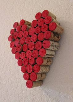 A group of red tipped corks forming a valentine heart. Scale up these corks on your wall as they form a big or small heart just in time for your Valentine celebration.