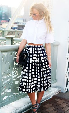 Mix a black and white patterned midi-skirt with a white cropped blouse for an edge on ladylike sophistication. // #Fashion