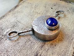 by Sheri Mallery Hollow sterling silver box with Lapis stone