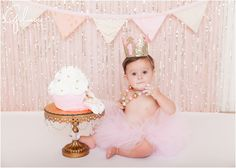 Ella's Cake Smash! 1st Birthday Portrait Session - Newport Beach Baby Photographer, CA, Cali, California, Pink Glitter, Light Pink, Pale Pink, Pastel Pink, Cake Stand, Golden Crown, First Birthday, Gold and Pink Necklace, Pink Tutu, Pink and White Cupcake Cake, Giant Cupcake, Girly, Princess, Baby Girl, Cute, Adorable, Precious, Messy, Smiley, Laughter, Darling, Feminine, Icing, Icing on Hands and Fingers, Beaded Necklace, Happy Girl, Eating Cake GilmoreStudios.com