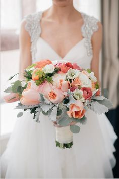 peach bouquet featuring tulips, garden roses, poppies and ranunculus with dusty miller by Pure Design