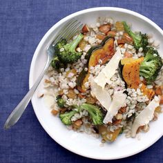 Nutty barley comes together with roasted vegetable like sweet acorn squash and broccoli in this hearty fall salad the whole family will love.