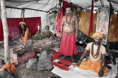 Sadhus from all over India attend Kumbh Mela, a religious Hindu event. These sadhus made a temporary home near the river bank, where they pray and give pilgrims religous advice.