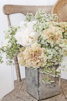 white colors floral arrangement for vintage rustic cottage chic wedding decor centerpiece