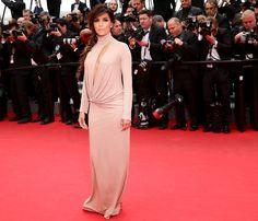 Eva Longoria's nude dress featured a plunging neckline. Cannes 2014