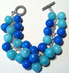Aquamarine and blue beaded charm bracelet   www.etsy.com/shop/radiantbyretha