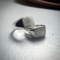 A pair of silver costume made friendship rings