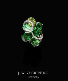 Nicely done cluster ring by J.W. Currens
