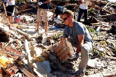 A Sailor from Strategic Communications Wing 1, joins a large group of Sailors as they volunteer on May 22, 2013, in support of recovery efforts in Moore, Oklahoma after adevasting EF5 tornado.