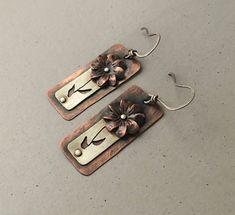 Mixed metal floral earrings, riveted flower earrings, silver and copper textured earrings by MetalingSusie on Etsy