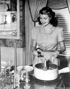 Rita Hayworth dishing up dinner. #vintage #1940s #actresses #food #domestic_life